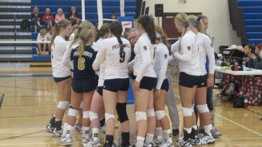 "The girls ""huddle up"" in their section game vs. Rockford. By; Beth Geurink"