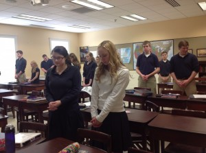 Students in Mr. Ian Skemp's study hall pause and noon to pray the Our Father.