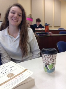 Melissa Ivens '14 smiles with her morning cup of coffee. By Rachael Maguire